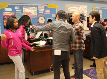 Nippon Television news crew interviews Buford Middle School students, Alisse Collick and Kiana Anderson.